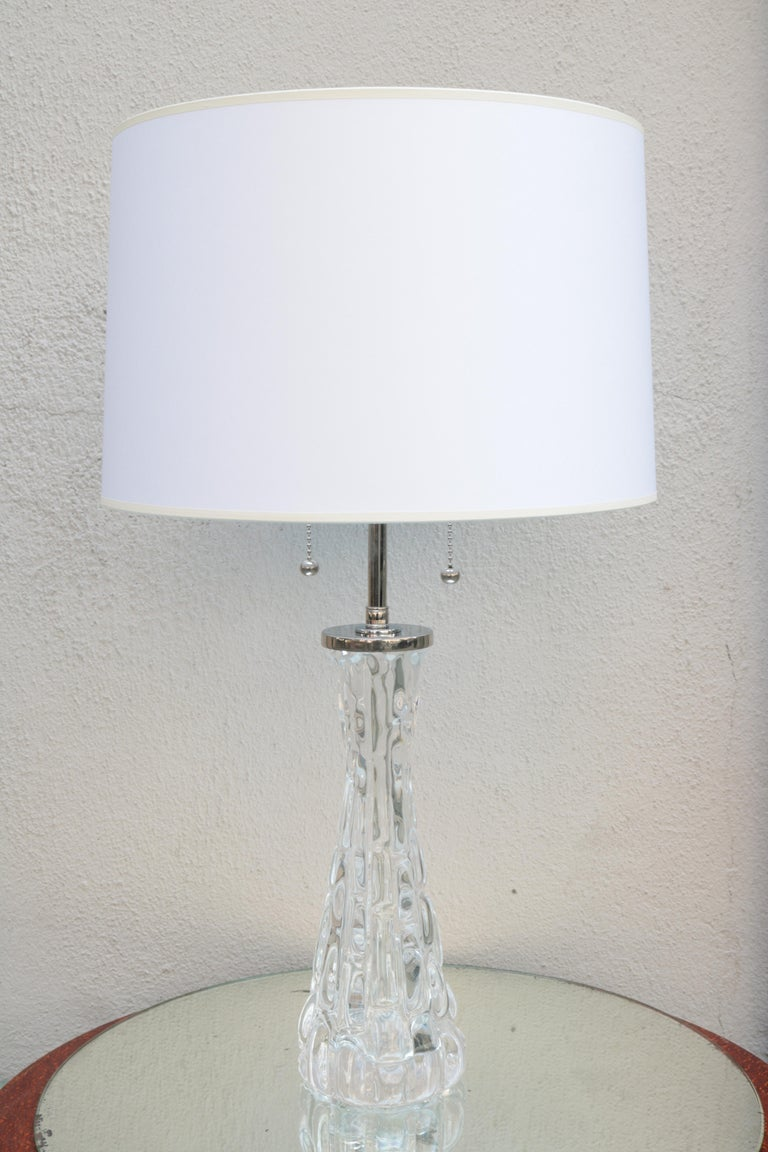 A pair of Orrefors Modernist crystal table lamps with Orrefors Signature.  Crystal and polished nickel.
