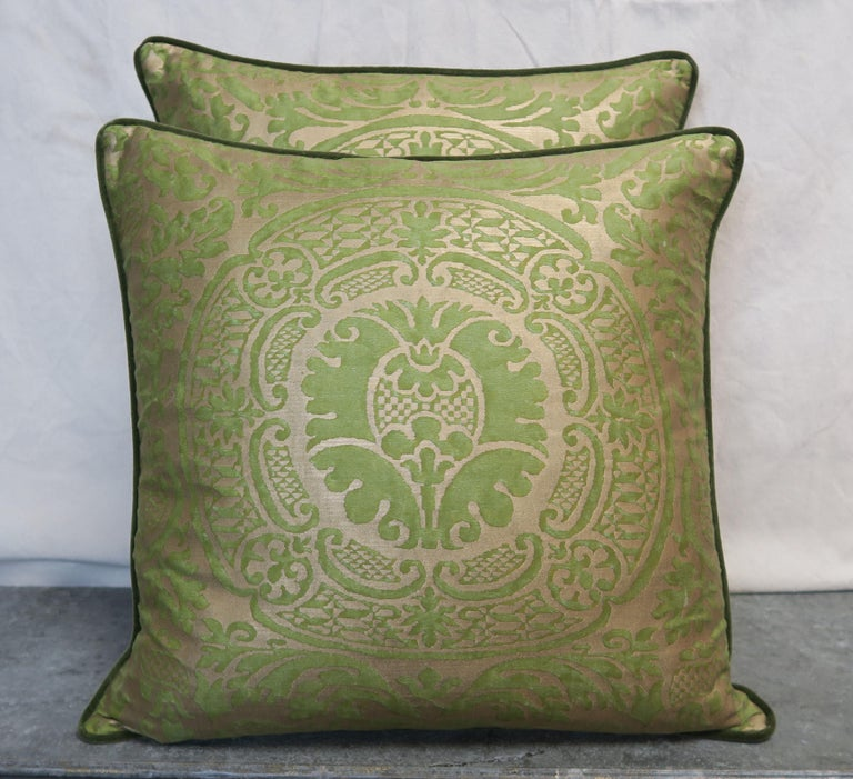 Pair of custom pillows made with Orsini patterned green and gold printed Egyptian cotton fronts and rich green colored velvet backs with self cord detail. Down inserts, sewn closed.
