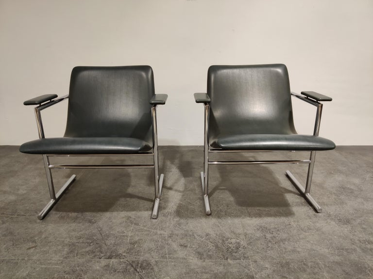 Pair of 'Oslo' lounge chairs by Rudi Verelst for Novalux.  These chairs seat very well due to their well-shaped seats  Seats and armrests are upholstered in black/grey skai or leatherette   Good condition.  1970s, Belgium  Dimensions:   Height 70 cm