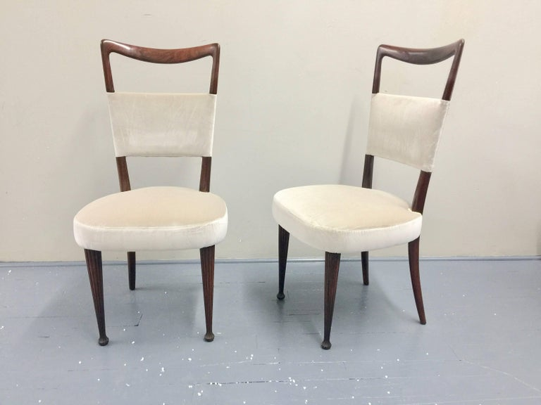 Four Osvaldo Borsani Chairs made of rosewood with new upholstery  100% cotton velvet from Italy.  The chairs have been restored and feature generous seat with carved front legs and more simple curved back legs. New velvet upholstery. Velvet can be