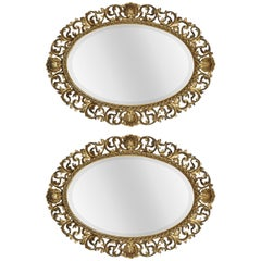 Pair of Oval Florentine Gilt Wall Mirrors