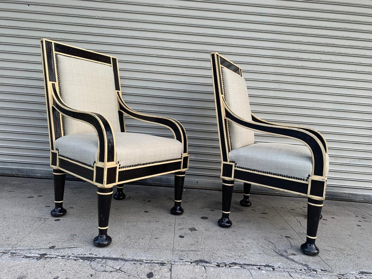 Beautiful pair of armchairs custom designed and built for a private client in Los Angeles.  The chairs are beautifully crafted and well designed, beautiful comination of colors having a crackle finish over the wood and a handwoven leather seat and