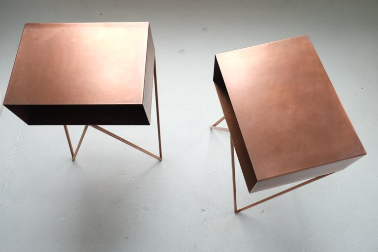 A pair of robot side tables with an oxidised copper finish. Each robot table is individually coated, hence they all have a different unique finish. Features a pigeon hole box shelf on zigzag legs, the quirky and functional design looks great against