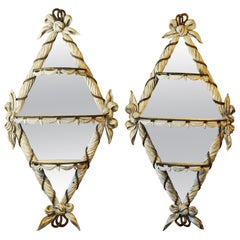 Pair of Paint and gilt Scarf carved Diamond Shape Mirrors with Demilune Shelves