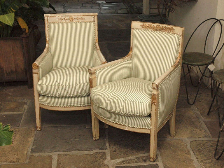 Painted with gilt accents. Splendid as a pair, note that the carvings do not match. Sizes are nearly identical, varying less than an inch in H, W, and D.
