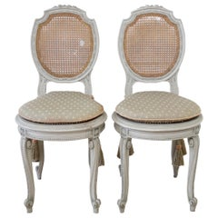 Pair of Painted Cane Back Ribbon Carved Vanity Chairs