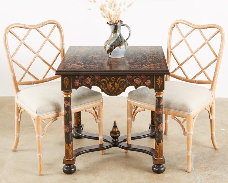 Extraordinary pair of lacquer painted lamp tables or end tables made in the French Louis XIII taste. Decorated with colorful floral motifs and faux aged craquelure lacquer finish. Supported by column style legs conjoined with curved x form