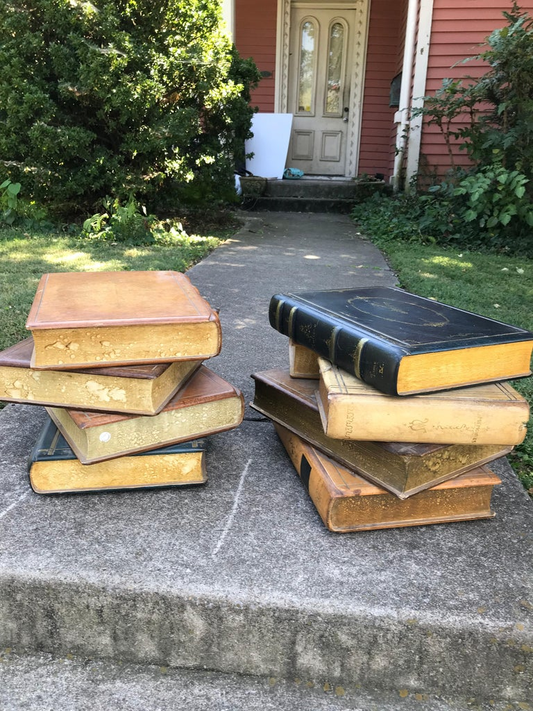 Colorful faux Books as low tables.  Provenance : Sir Rex Harrison , New York. Sculpted in Wood and painted ,gilt decorated . The finish extremely hard and durable (possibly fired ).Some light wear, dirt , grime. Some fasteners form head under the