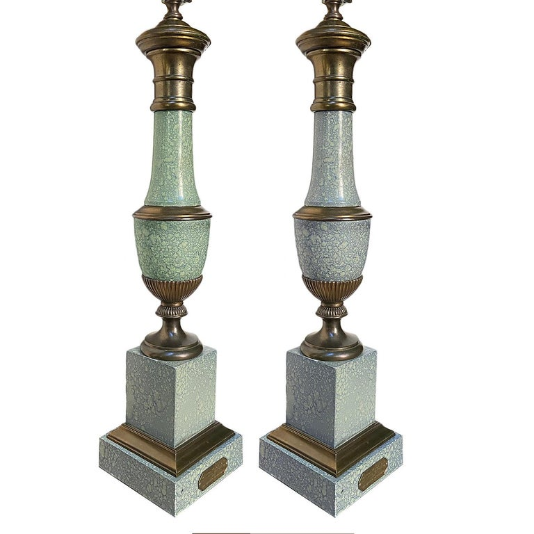 Pair of circa 1930's French painted tole lamps with brass details.  Measurements.  Height of body: 23