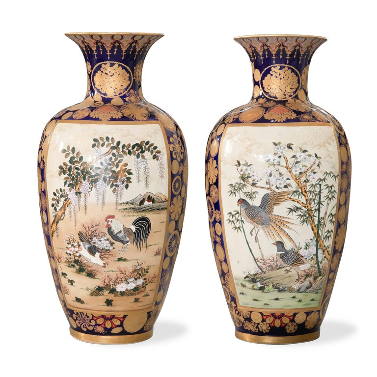 Offered is a pair of palace sized vintage Japanese Kutani/Satsuma vases with pre 1921 markings on base. The vases are in good condition with some glaze crackalure in keeping with their age. They measure 33.5