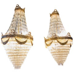Pair of Palatial Bronze and Crystal Swag Design Louis XVI Style Chandeliers