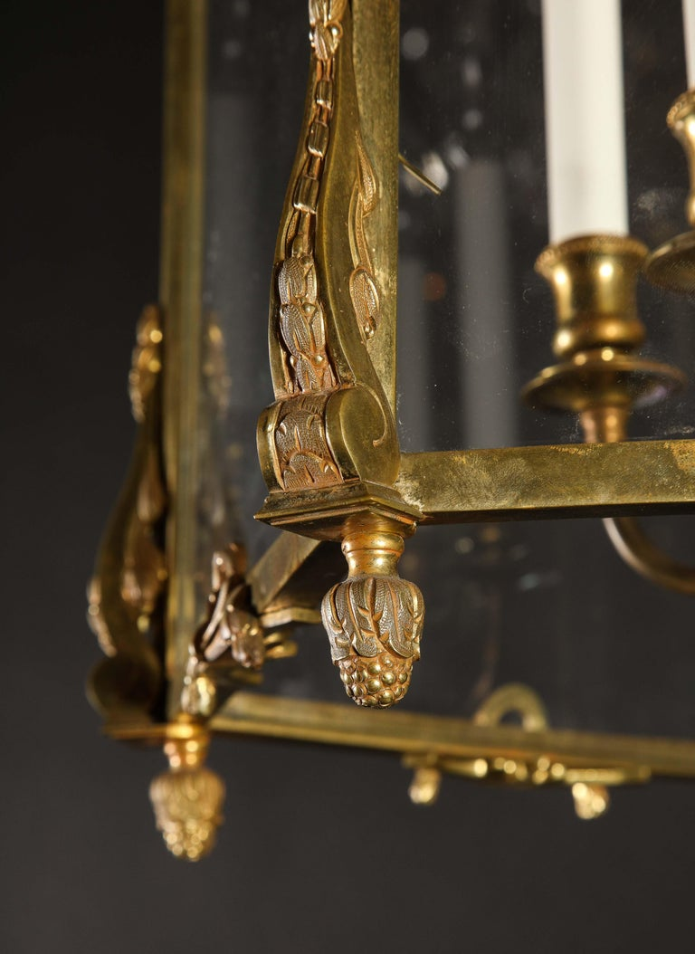 A Pair of Palatial superb French Louis XVI style gilt bronze multi light Lanterns of exquisite craftsmanship with glass panels and further embellished with unusual gilt bronze floral wreaths. Each lantern has interior gilt bronze arms.