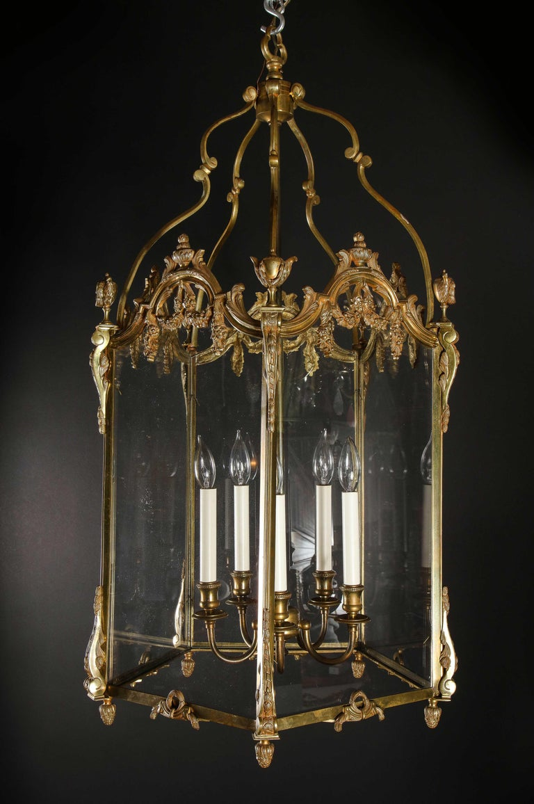 20th Century Pair of Palatial French Louis XVI Style Gilt Bronze and Glass Lanterns For Sale