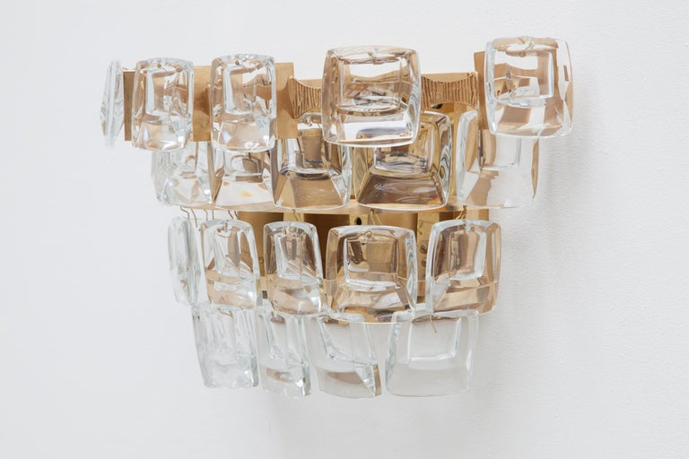 A set of 1950s wall lights, sconces by Palme and Walter, Germany, labeled.