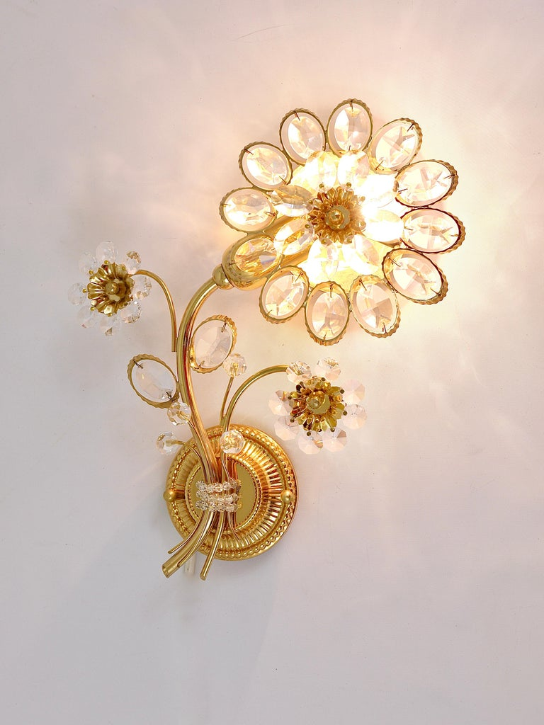 A pair of beautiful floral sconces, manufactured in the 1970s by Palwa, Germany. Made of gilt brass with crystal glass petals. In excellent condition.