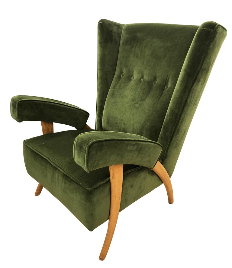 """Pair of beautiful 1950s Paolo Buffa lounge chairs with """"tusk"""" shaped legs. Upholstered in a dark green velvet.  Condition: Excellent vintage condition, minor wear consistent with age and use.  Measures: Width 28""""  Depth 31"""".  Height"""