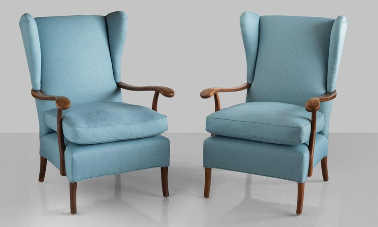 Pair of Paolo Buffa armchairs, Italy, circa 1950.  Modern wingback armchairs with carved wooden arms, newly reupholstered in Maharam Fabric.