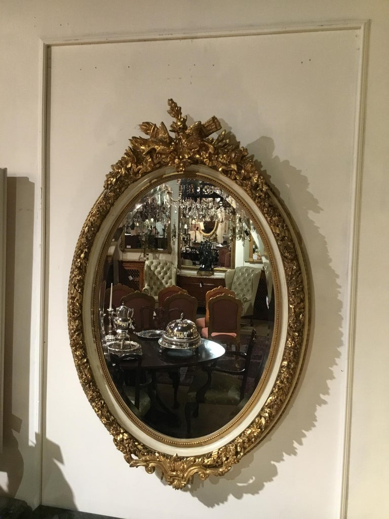 Pair of Parcel Paint and Parcel Gilt Beveled Oval Mirrors, with Bird Carvings For Sale 4