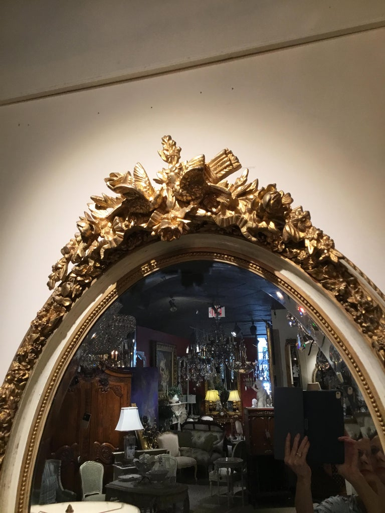 Pair of Parcel Paint and Parcel Gilt Beveled Oval Mirrors, with Bird Carvings For Sale 2