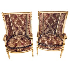 Pair of Parcel Paint and Gilt Decorated Louis XVI Style Wingback Armchairs