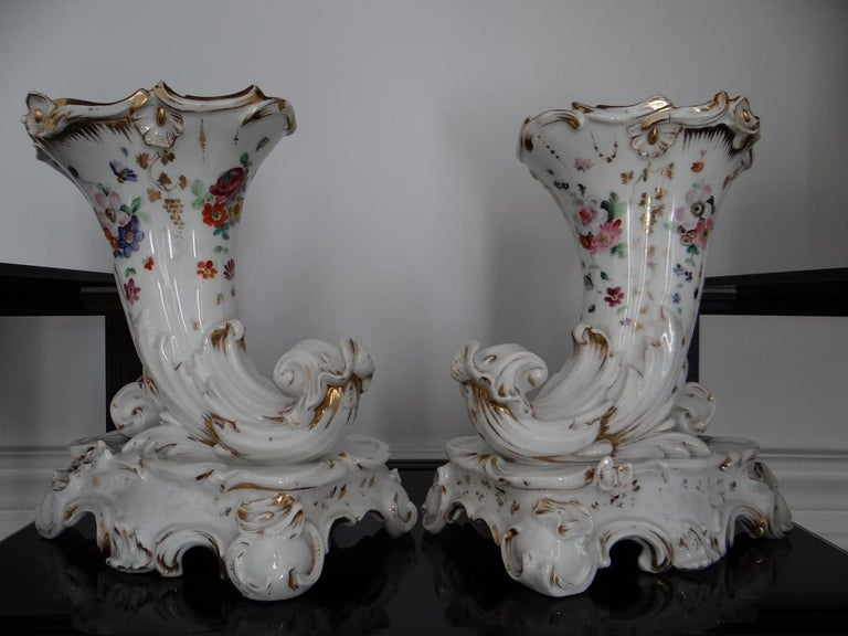 Lovely pair of flower Paris porcelain period Louis Philippe horns of plenty. It presents a very pretty decoration of flowers seedling on a dough of a very beautiful whiteness. A monogram in undercover blue is visible under the base. It corresponds