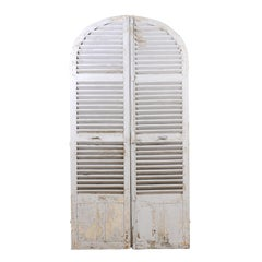 Pair of Parisian French 1880s Painted Wood Arched Shutters with Weathered Patina