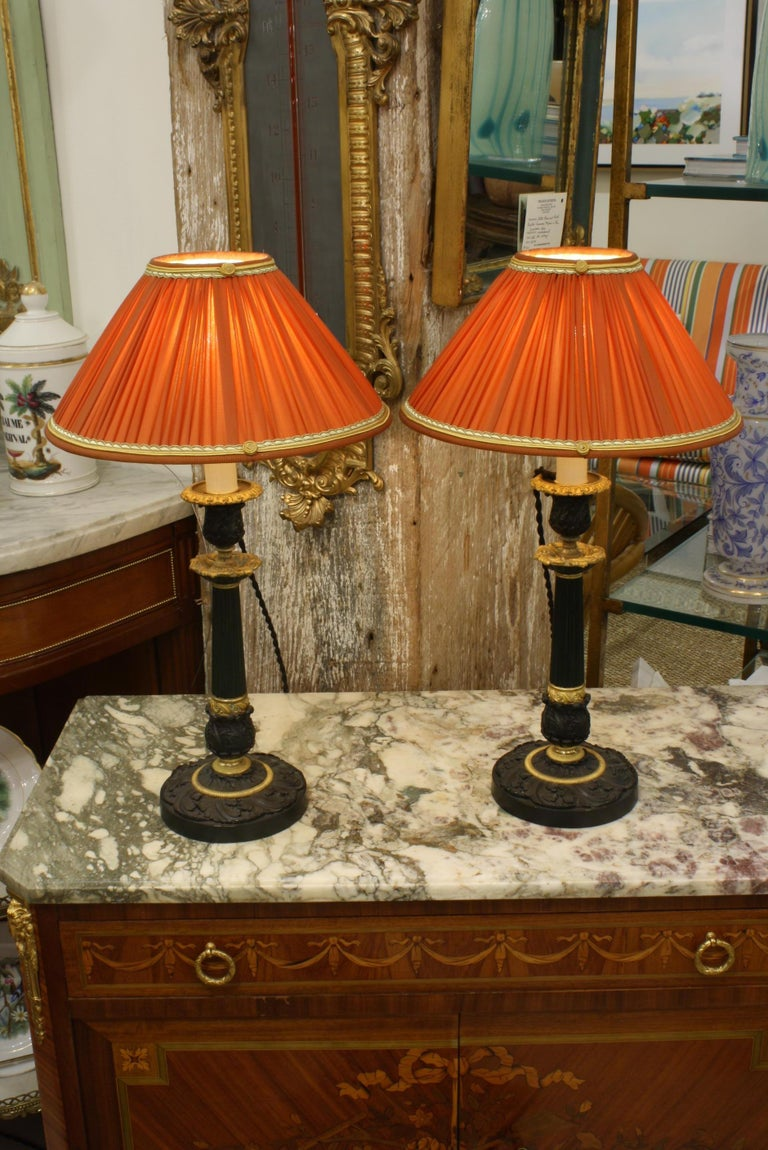 Restauration Pair of Gilt and Patinated Bronze Candlestick Lamps with Orange Silk Shades For Sale