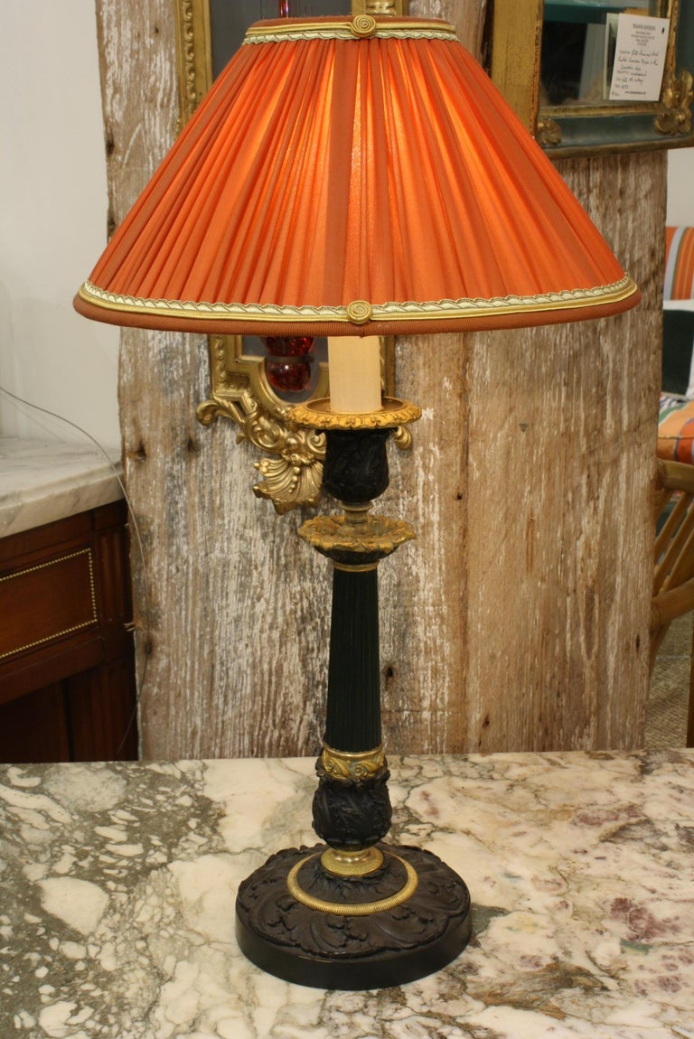 Pair of Gilt and Patinated Bronze Candlestick Lamps with Orange Silk Shades In Good Condition For Sale In Charleston, SC