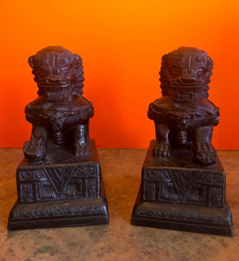 Impressive pair of patinated bronze Chinese foo dogs / book ends, circa 1930s. Excellent vintage condition with amazing detail and a gorgeous patina. Each dog measures 6.5
