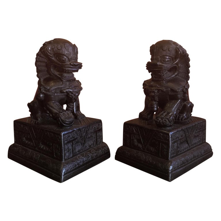 Pair of Patinated Bronze Chinese Foo Dogs / Book Ends For Sale