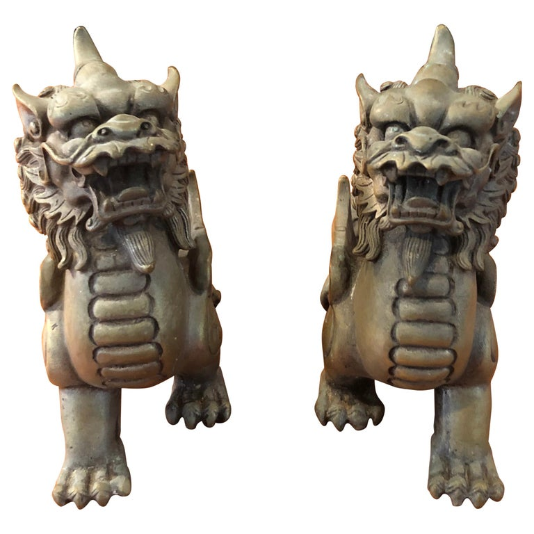 Pair of Patinated Bronze Chinese Foo Dogs For Sale