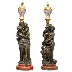 Pair of Patinated Bronze Figural Torcheres after Albert Carrier-Belleuse