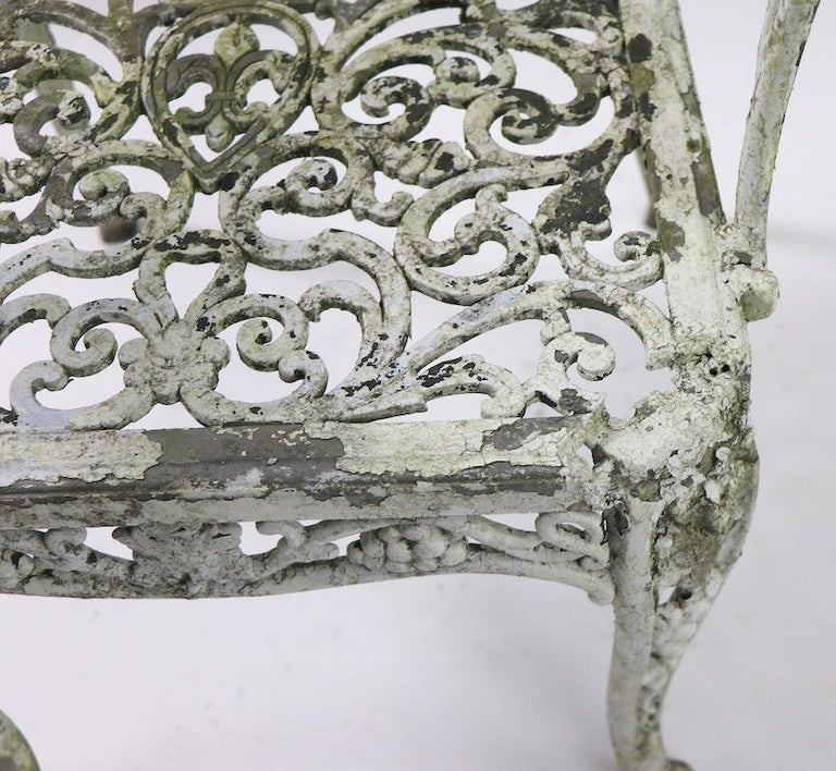 Pair of Patinated Cast Metal Garden Chairs In Fair Condition In New York, NY