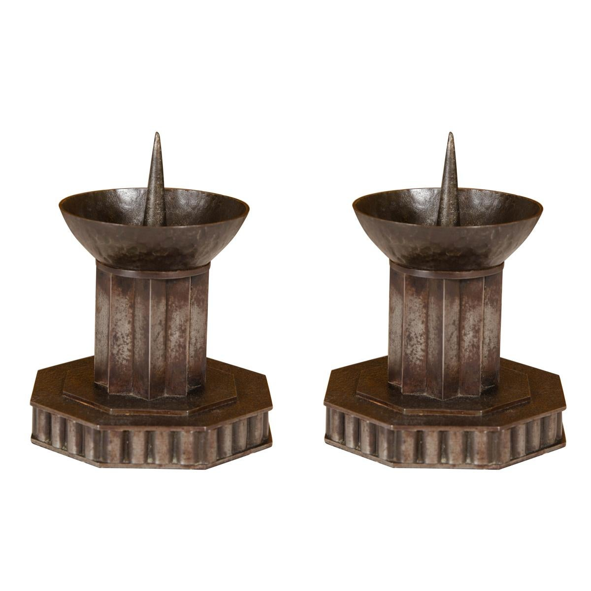 Pair of Patinated Iron Candlesticks