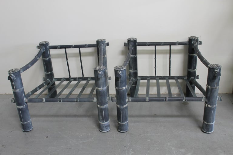 """Monumental pair of aluminum chairs and ottoman. They are an original grayish color with white accents. Bamboo pattern. The chairs measure 32.5"""" deep, 37"""" wide (front), 32.5"""" wide (back) and 29"""