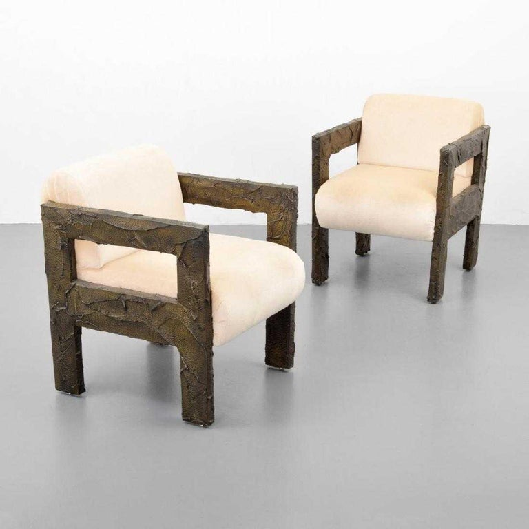 Pair of sculpted bronze lounge chairs by Paul Evans for Paul Evans Studio. Chairs are accompanied by a Letter of Provenance issued by Dorsey Reading, dated 11.16.2018.  Materials: bronze resin, upholstery.