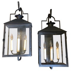 Pair of Paul Ferrante Antiqued Glass and Iron Baxley Lanterns