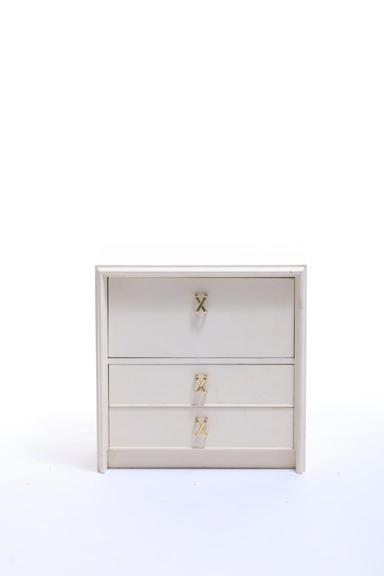 Pair of Paul Frankl Ivory Lacquered Night Stands with Brass X Pulls, circa 1950 In Good Condition For Sale In Saint Louis, MO