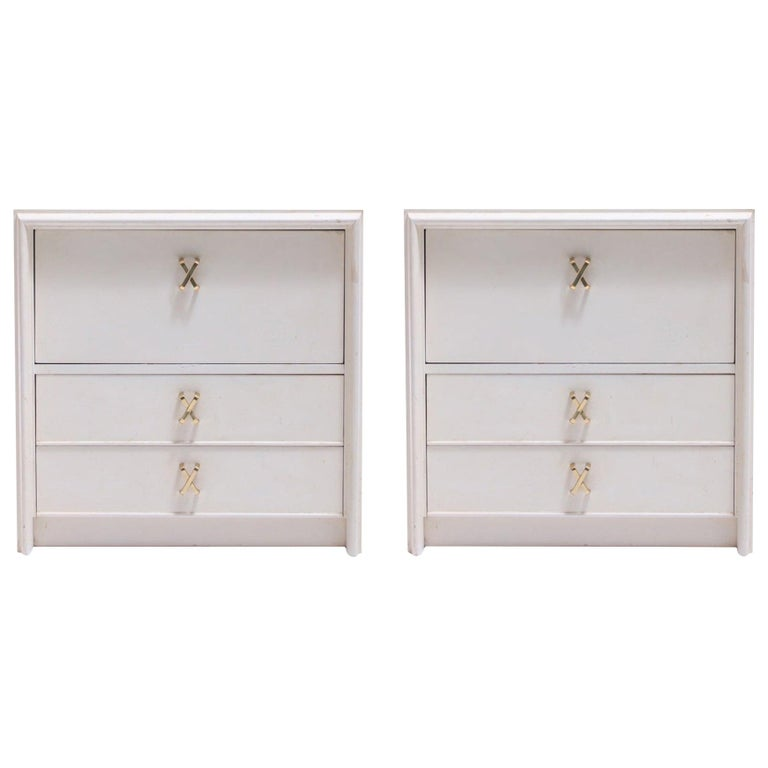 Pair of Paul Frankl Ivory Lacquered Nightstands with Brass X Pulls, circa 1950 For Sale