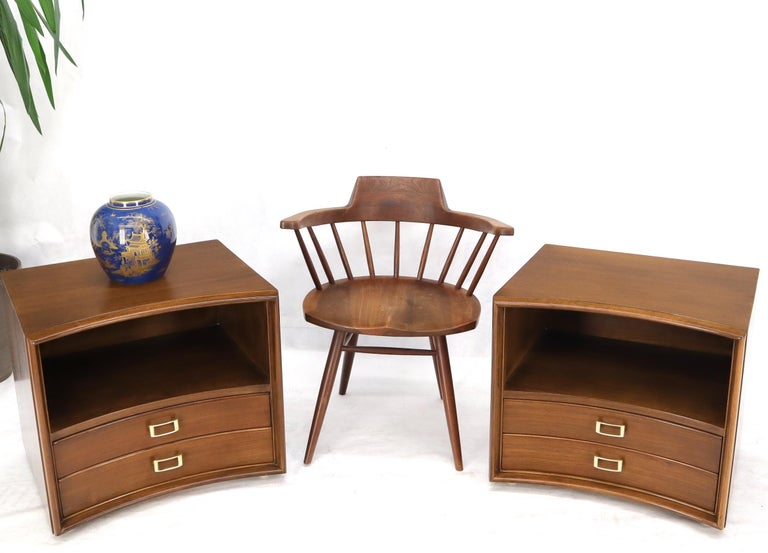 Pair of stunning Mid-Century Modern walnut end tables night stands with solid brass buckle shape pulls.