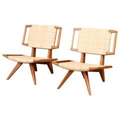 Pair of Paul Laszlo Cane Lounge Chairs