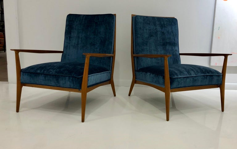 Classic and somewhat rare pair of armchairs in walnut with new silk upholstery. Great lines and nicely proportioned. Newly refinished.