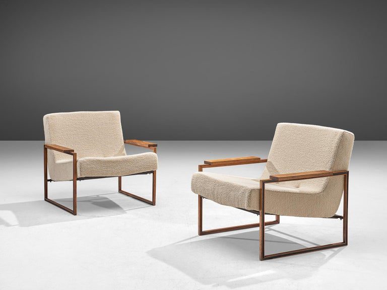 Percival Lafer, pair of armchairs, Brazilian hardwood and fabric, Brazil, 1960.  This stunning pair of Brazilian armchairs are a pair you do not want to miss in your interior. An extraordinary early design of Percival Lafer, featuring a slim,