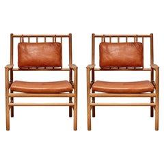 """Pair of """"Peter"""" Oak and Leather Lounge Chairs by Arne Norell"""