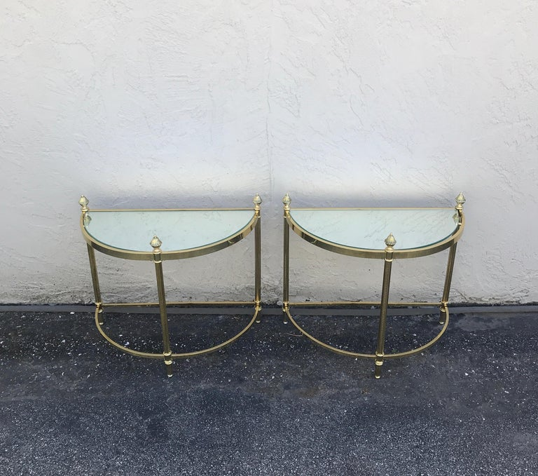 Pair of demi lune brass drinks tables by Maison Jansen.