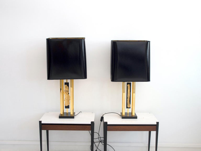 Pair of large table lamps by French artist and designer Philippe Cheverny from circa 1970. Black laminated wood base, brass framework and golden metal decoration on black Perspex. Sleek black and golden shades have been replaced, but the size is