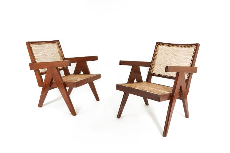 Pair of easy chairs from the administrative offices of Chandigarh (PJ-SI-29-A). Restored and recaned in natural cane. Cushions not available.