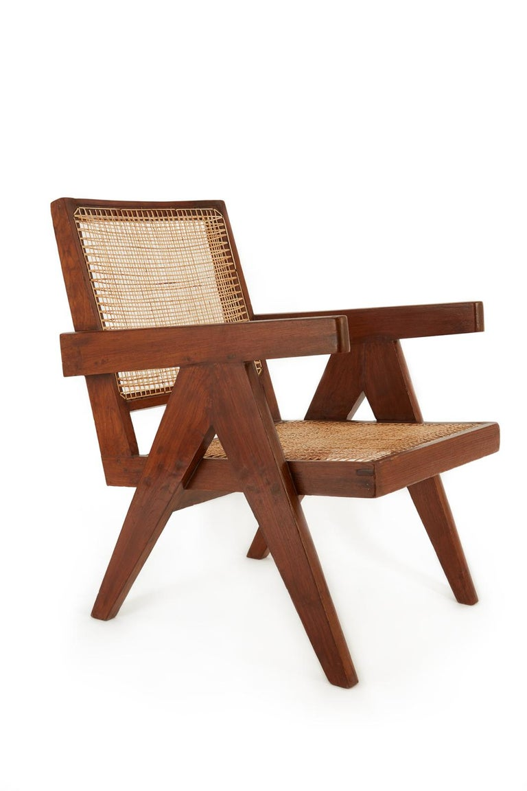 Pair of Easy Chairs from the administrative offices of Chandigarh (PJ-SI-29-A).  The pair comprises two closely matching chairs, minor incongruities on the dimensions are due to the handmade production.  Recently restored and recaned in natural
