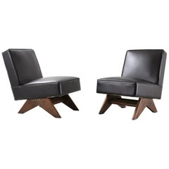 "Pair of Pierre Jeanneret ""Fireside"" Chair, circa 1955-1956"