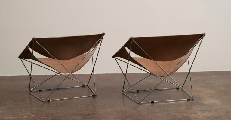 A handsome pair of Pierre Paulin Butterfly chairs, model #675 in original cognac leather with lovely patina.